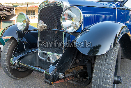 headlights and radiator of antique car