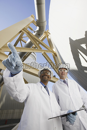 scientist pointing forward with another scientist