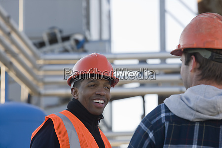 two engineers discussing at an asphalt