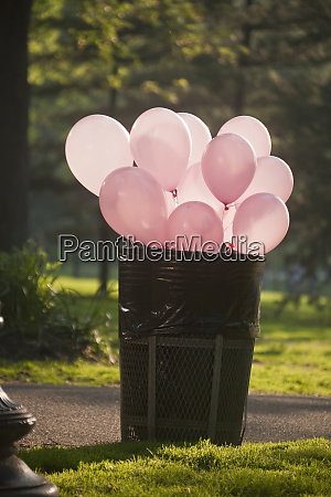balloons in a garbage can in