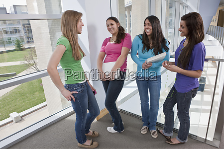 students talking in the college hallway