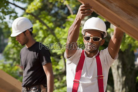 carpenter placing rafters