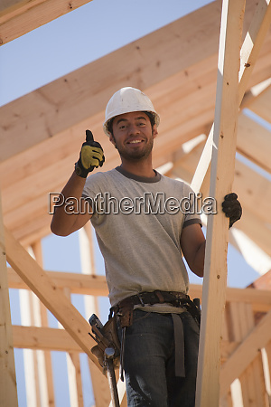 carpenter showing thumbs up sign and