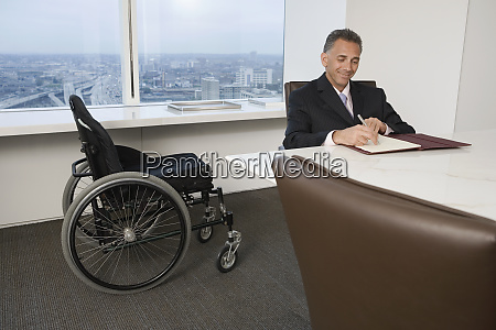 businessman with a wheelchair working in