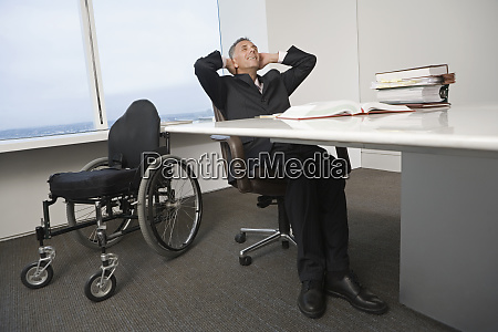 businessman with a wheelchair relaxing in