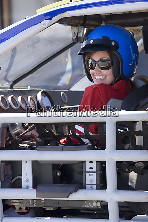smiling female disability auto racer