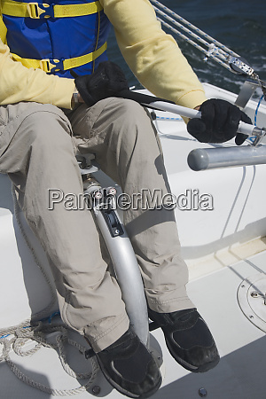 disabled man steering boat low section
