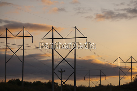 clouds over electricity pylons