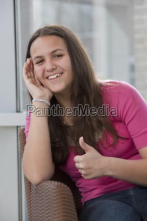 hispanic teenage girl smiling