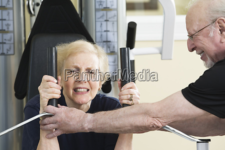 senior couple exercising in the gym