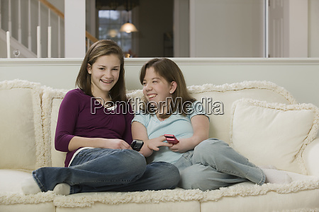 two teenage girls sitting on a
