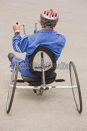 disabled man riding a racing bike