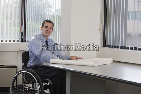 businessman with spinal cord injury holding