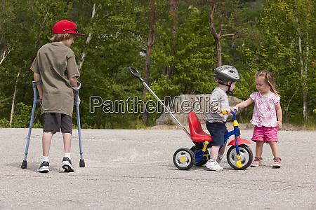 boy with degenerative disease using crutches
