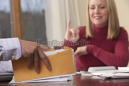 woman signing the word insurance in