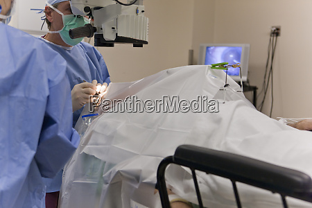 doctor using forceps to score the