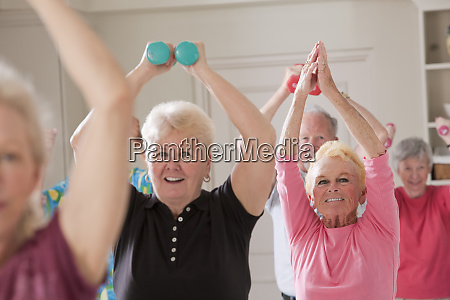 seniors exercising with dumbbells in a