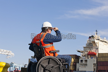 transportation engineer in a wheelchair inspecting