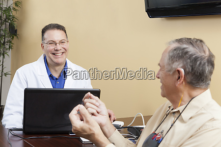 patient providing feedback to an audiologist