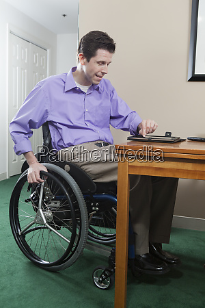 quadriplegic man in wheelchair with spinal