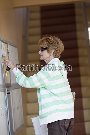 senior woman getting her mail