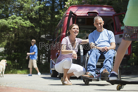 couple watching their son on skate