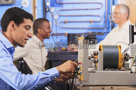 student setting up generator experiment while