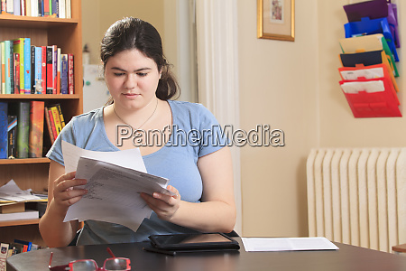 woman with asperger syndrome sorting through