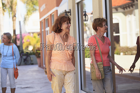senior friends looking in a store