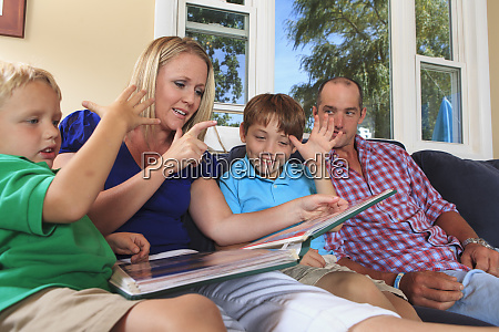 family with hearing impairments watching photo