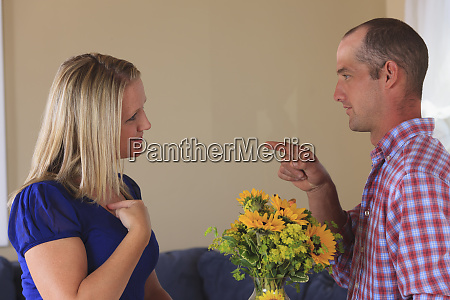 husband with flowers signing for you
