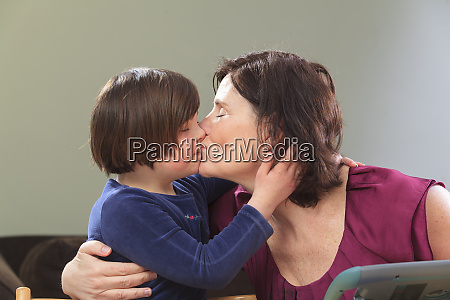 little girl with down syndrome kissing