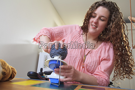 woman with muscular dystrophy working with