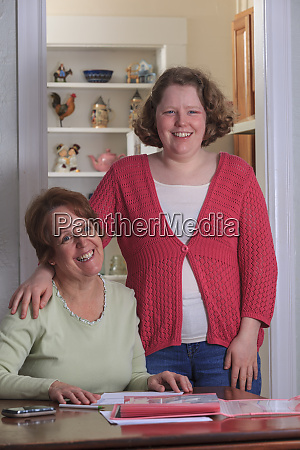 mother helping daughter with autism fill
