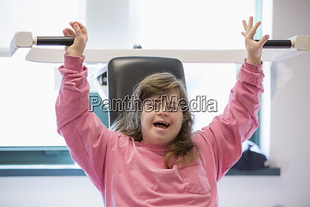 young woman with down syndrome working