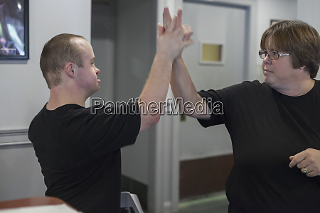waiter with down syndrome high fiving
