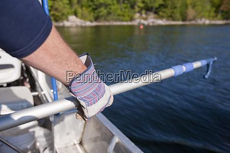 scientist preparing boat hook to gaff