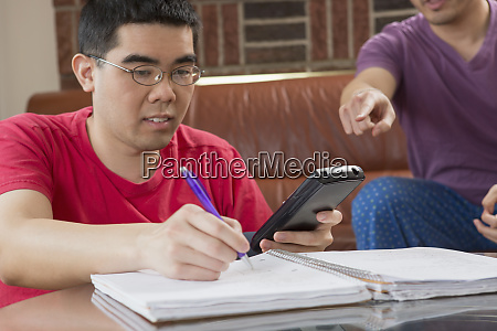 asian man with autism working on