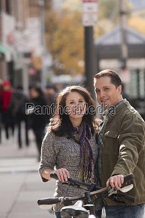 couple standing with bicycles