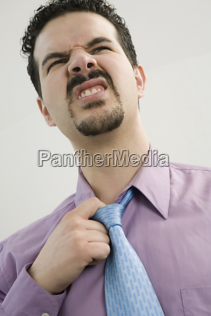close up of a businessman loosening