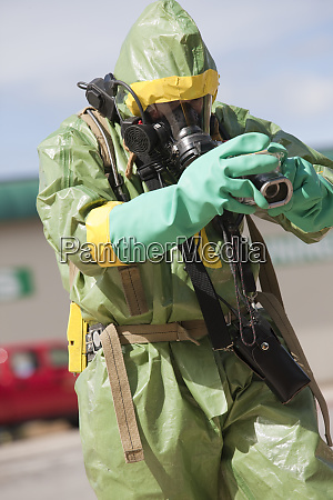 hazmat firefighter working with a camera
