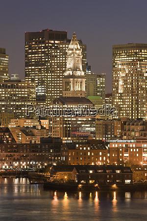 buildings lit up at night custom