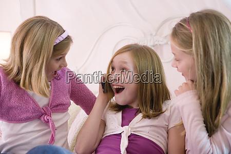 view of three surprised girls