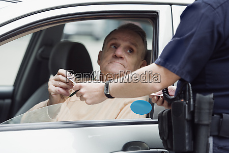 police sergeant checking drivers license