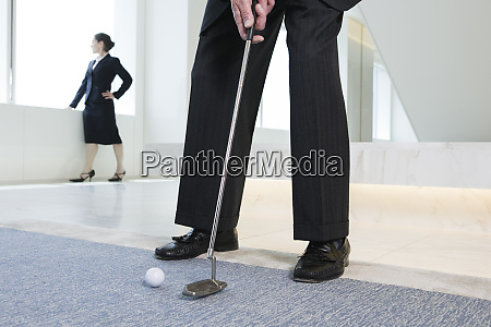 business executive playing golf in the