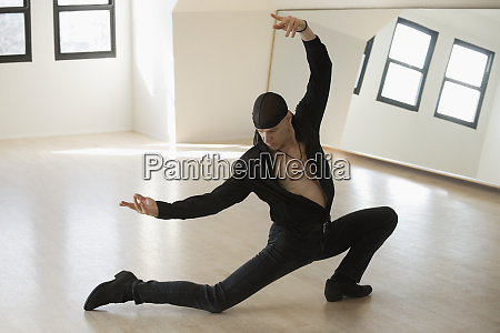 mid adult man practicing spanish ballet