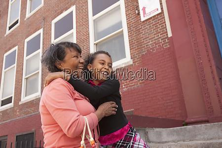 hispanic girl smiling with her grandmother