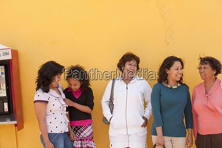 hispanic family waiting at bus stop