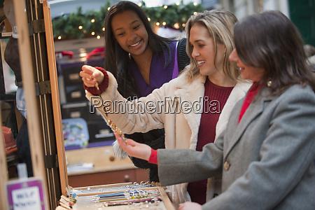 women friends shopping for jewelry in