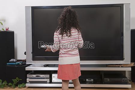 hispanic girl standing in front of